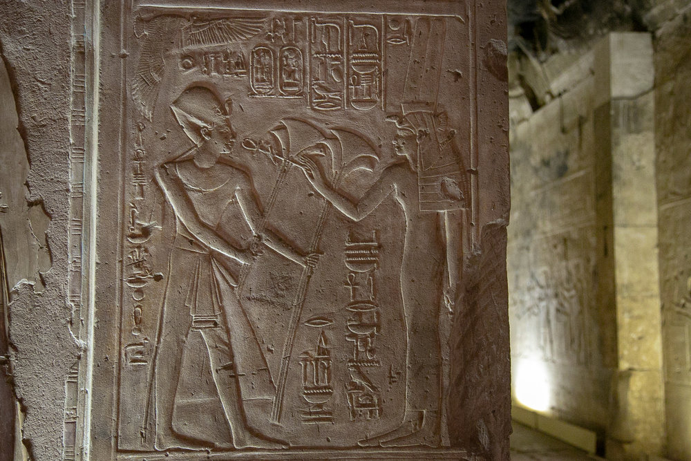 Raised-relief hieroglyphs in an Egyptian temple.