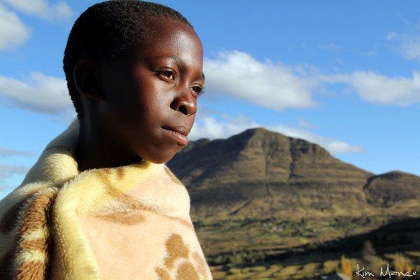 A teenage village girl wearing a Basotho blanket.