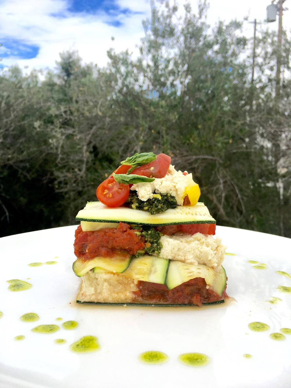 Heirloom tomato lasagna // macadamia ricotta / pistachio pesto / red pepper marinara