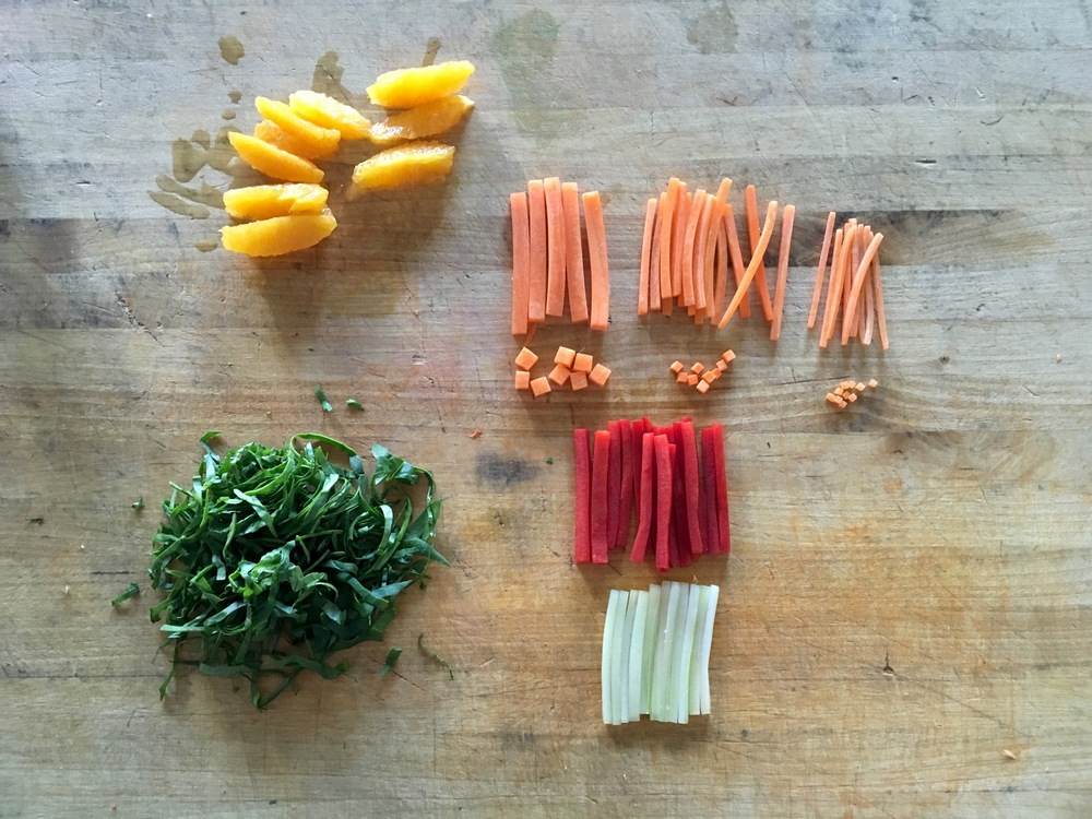 Knife skills errday! From top left clockwise -  Orange supreme; carrots: baton, small dice, julienne, brunoise, fine julienne, fine brunoise; julienne red bell peppers; julienne celery and spinach chiffonade