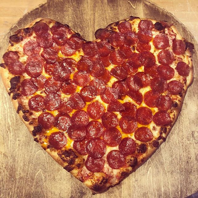 Forget the heart shape box of chocolates - You know how to really show you love someone - love pizza.  Cooking up some special request heart pizzas today ❤️ 🍕❤️ #papakenoslawrence #pizzalove