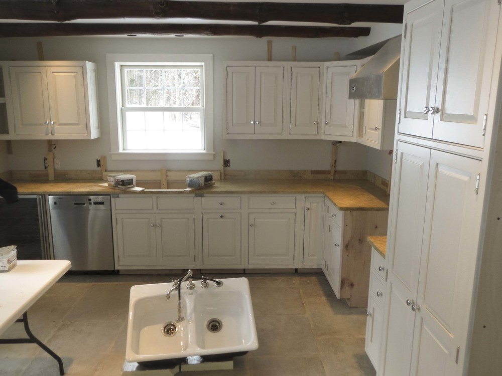 The water damage called for replacing most of the kitchen and creating an entirely new beautiful space.