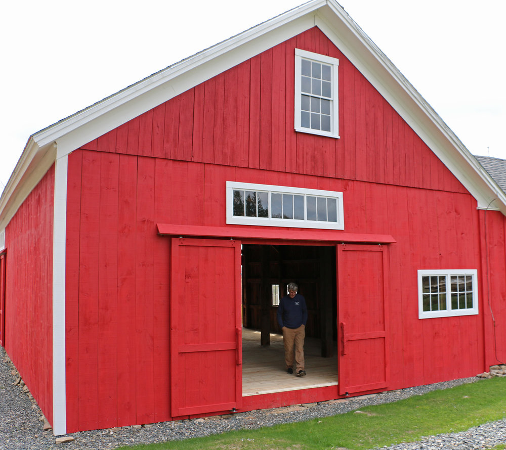 New doors and a fresh coat of paint finish off the project and bring the barn back to its previous beauty.
