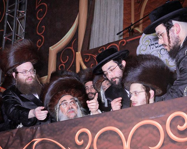 "I've recently read a lot to clarify some of the history of Satmar and why there are currently two Grand Rebbes of Satmar. Rabbi Yoelish (Joel)Teitelbaum (1887-1979) founded the Satmar dynasty. Childless, his nephew Moshe (1914-2006) succeeded him. When Joel died his second wife Feige (1912-2001) attempted to take over the dynasty, she was close, but was overlooked since the lineage problem would present itself again after she died (a woman becoming the head of a Hasidic dynasty would have been fascinating). As an added complexity, Feige detested Moshe because Moshe was said to have told Joel to divorce her and remarry a third time (various people now say that numerous Rabbis at the time suggested he take two wives, citing polygamy in the bible) and try keep direct lineage (a move that was altruistic for Moshe, because Moshe would not have become Grand Rebbe had Joel had a child.) At the time, the community must have felt relieved since Moshe had many sons and his eldest, Aaron (b.1947 seated, pointing above) was in line to take over the dynasty, since he was a charismatic Torah scholar himself. However, toward the end of Moshe's life he suffered from dementia. Feige's followers came back onto the scene. Unable to point their frustrations at the infirm Grand Rebbe, they directed their anger at the heir apparent, Aaron. They spread rumors, even suggesting that Aaron's wife was a ""Zionist-sympathizer"" (Satmars are fiercely anti-Zionist). Aaron's younger brother, Zalman who was appointed by Moshe as a Rabbi in Williamsburg, soon became more popular as anti-Aaron rhetoric continued. The disagreement between two factions, known as ""Aaronis"" and ""Zalis"" at times became physical. In 2006 when Moshe died, the Zalis miraculously produced a will, signed in 2002, stating that Moshe decided that Zalman should take over his post in Williamsburg and with that, the helm of the Satmar dynasty. Aaronis argued that Moshe had dementia and must've been coerced. Defeated, Aaron retreated to Kiryas Joel with just 1/4 the followers his brother had."
