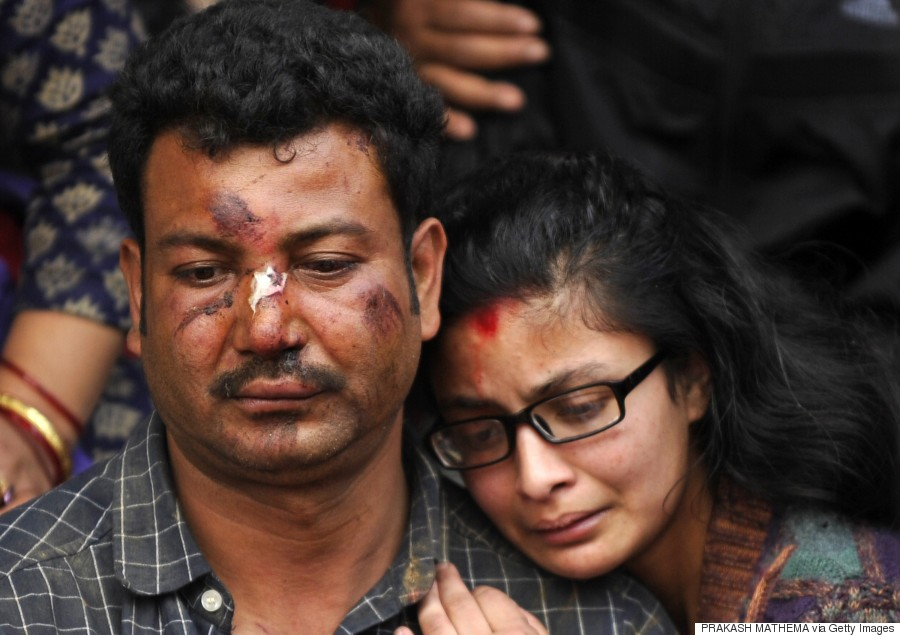 Krishna Bhakta Koju (center) breaks down at the cremation of his daughter in Bhaktapur on the outskirts of Kathmandu on April 26, 2015. (PRAKASH SINGH/AFP/Getty Images)