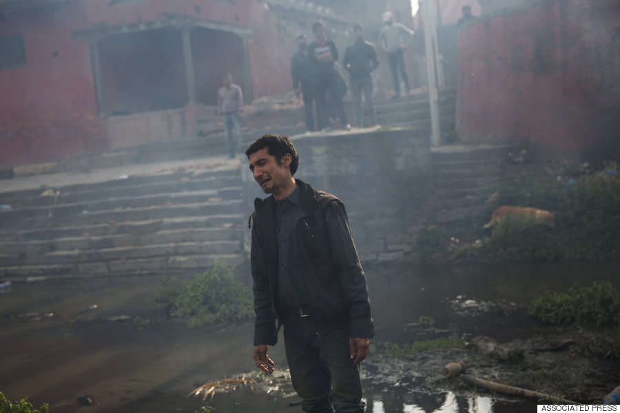 A man cries during the funeral of his sister at the Pashupatinath Temple, on the banks of Bagmati River in Kathmandu, April 26, 2015. (AP Photo/Bernat Armangue)