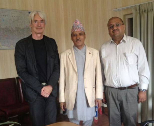 Nepal's Chief Secretary Leela Mani Paudyal receives Himalayan Consensus Executive Board members Laurence Brahm and Sujeev Shakya at the Prime Minister's Office in Kathmandu