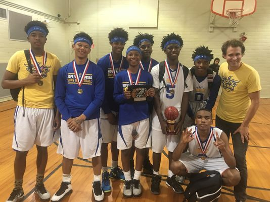 The Hope For Opelousas basketball team won its third straight Athletes For Christ League title. Pictured are: Ty Thomas, Chris Sapp, Kevin Coleman, Keith Biagase, Leo Franklin, Emmett Sanders, Isaiah Charles, Kevin Thomas, and HFO Executive Director Loren Carriere.