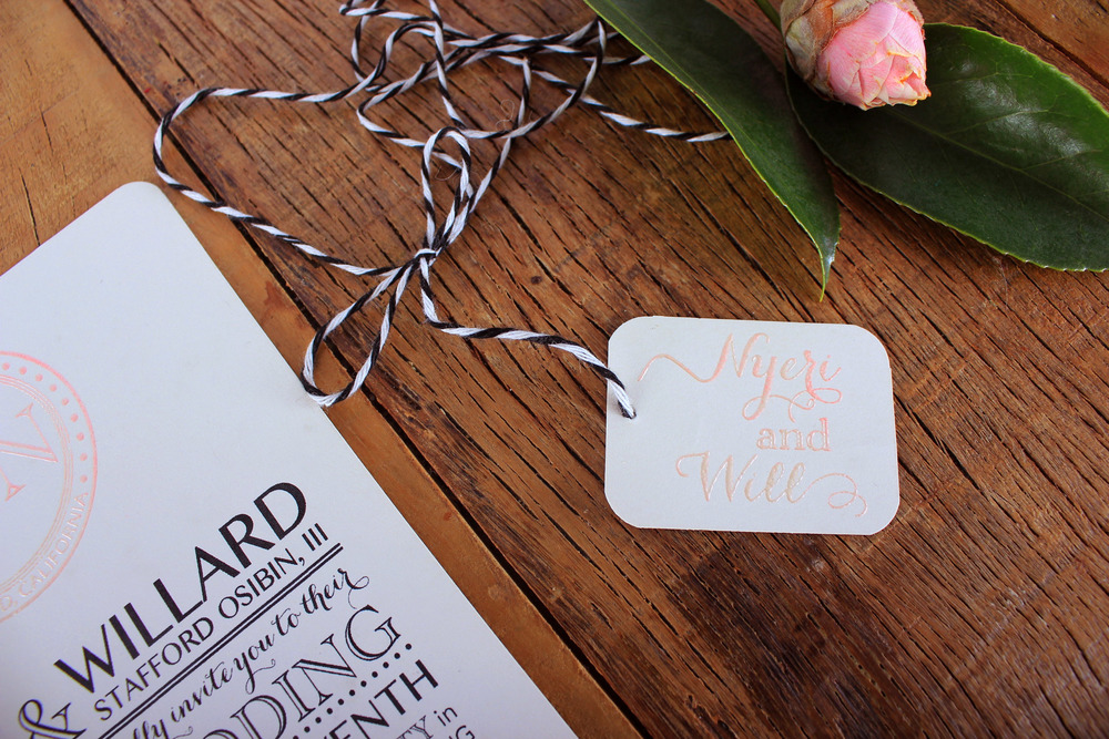 invite & rsvp held together with twine and embossed name tag