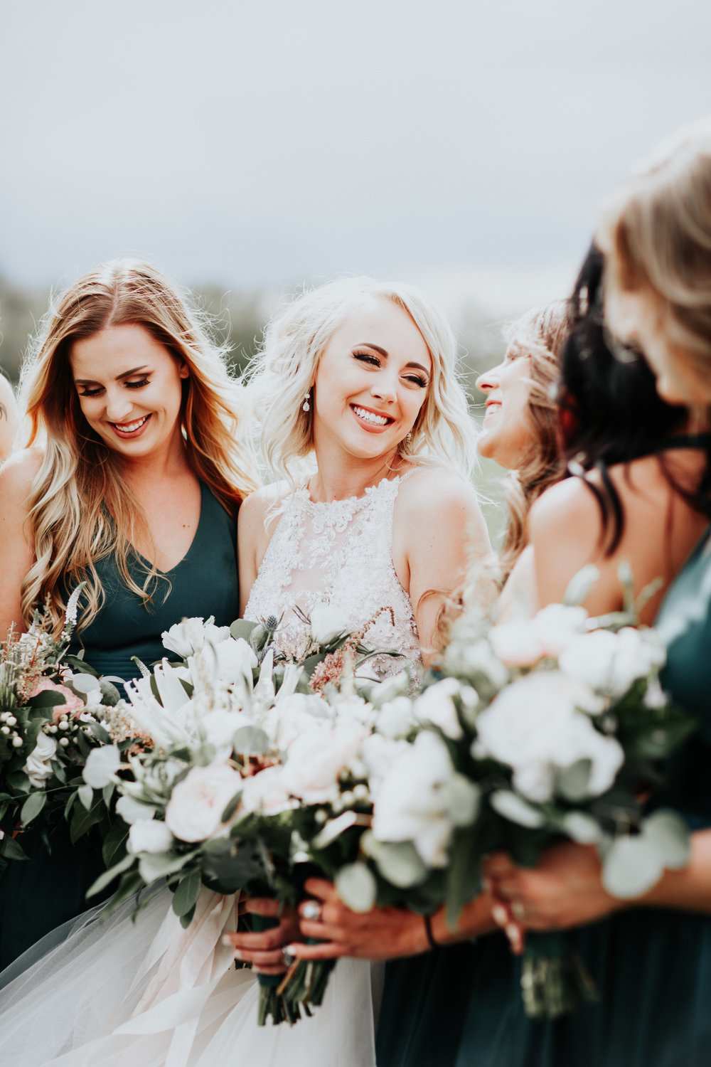Taylor + Wyatt - The best part of working with this family was seeing all the love they had for each other. Taylor and Wyatt could not be more set up for success in the upcoming years. Working with Darcie (MOB) was a dream come true. Taylor gave me design freedom when it came to her floral concepts which allowed me to sneak in a few surprises. A few of my favorite details were all the greenery we used on the tables, deer sheds from the groom, the brides signature Huckleberry Lemonade drink (I'm a sucker for anything Huckleberry) and the sunset pictures that we didn't even think we were going to get from the talented Alex Lasota.Planning + Floral