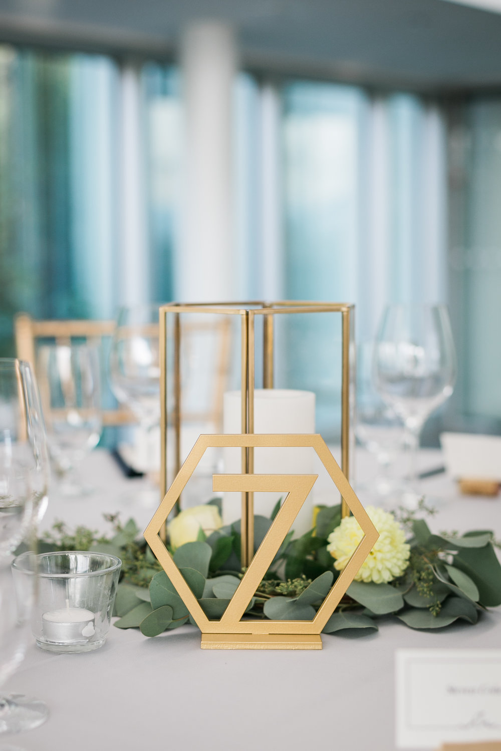 seattle-wedding-reception-party-geometric-candles-greenery-yellow-floral