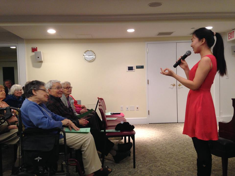 NEC student Hongge Du interacting with her audience at Lasell Village! Photo taken from NEC's CPP Facebook page. Go ahead and like it!