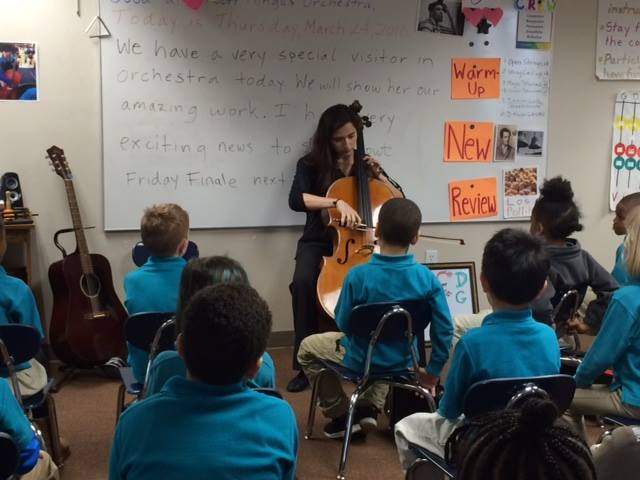 NEC Teaching Fellow, Marza Wilks, performing for the students at the Conservatory Lab Charter School! Photo taken from the NEC CPP Facebook page.