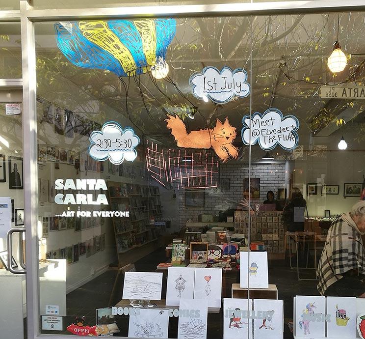 Window art promoting the event at Santa Carla, Brunswick, Victoria.