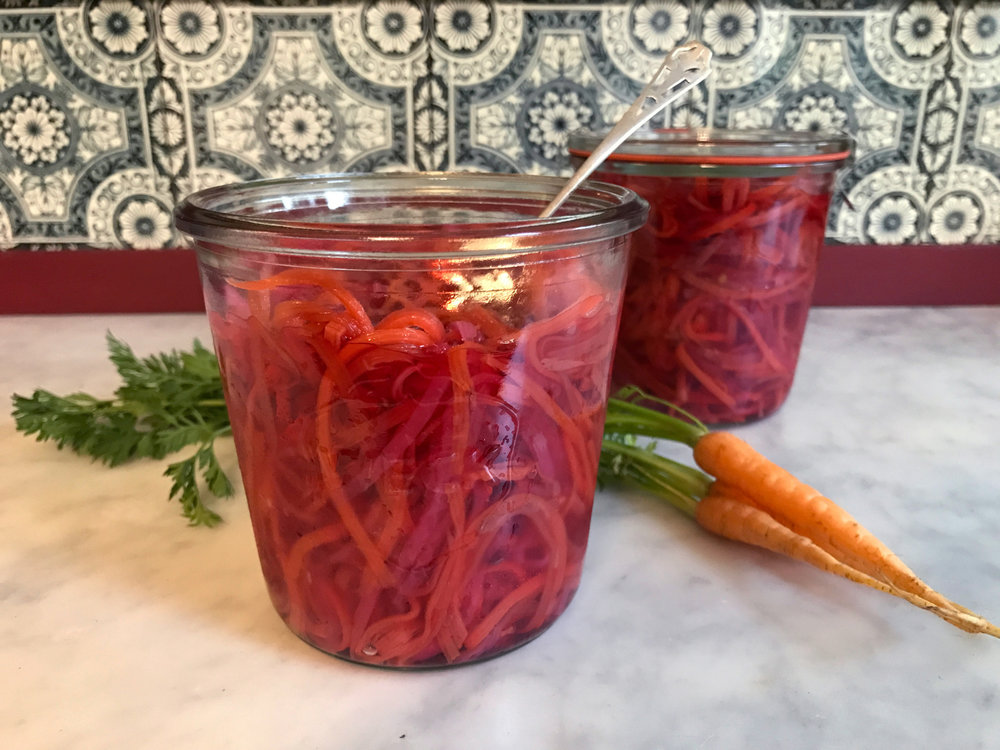 Gluten free and FODMAP Friendly shredded quick pickled carrots and daikon by Posh Belly's Kitchen make a refreshing snack and are a fantastic way to add a bit of zing to salads, sandwiches, tacos and many other dishes.