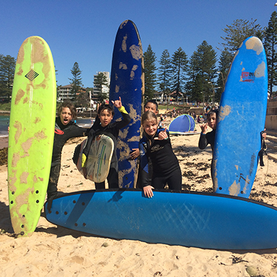 Kids School Holiday Surf Camps - Operate every day on Dee Why Beach during School Holidays from 10am to 2pm, Includes Two Surf Lessons, Surfboard and Wetsuit, lunch and beach games. Beginners to advanced levels.  Click here to read more...