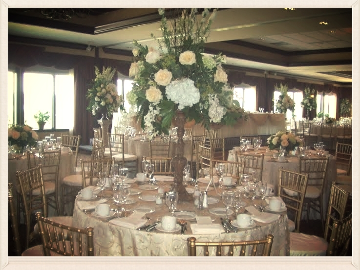 This Classic Elegant Wedding Features Stunning Floral Arrangements, Chiavari Chairs, Elegant Overlays, Custom Menus and Linens.