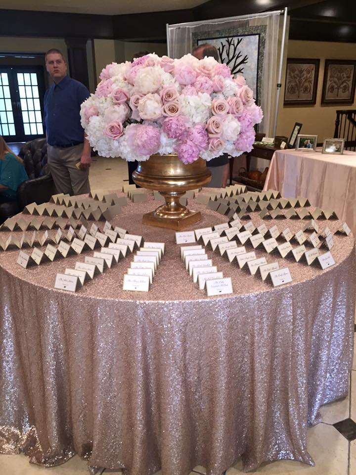 Round Place Card Table with a Stunning Floral Centerpiece