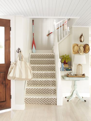 The trellis wallpaper is very graphic and adds a modern motif in this home. – Country Living, March, 2015