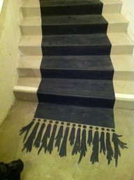 Painted Runner with Tassels – This is a way to break up the monotony of a traditionally painted staircase.    The tassels add whimsy and even more interest.    (bjtodesigns.com)