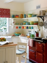 We love this small kitchen designed by Kathryn Ireland and seen on HGTV.com - the open shelving and the bright and colorful Fiesta Ware add a major dose of charm to this light-filled space. (Edward Addeo, photographer)