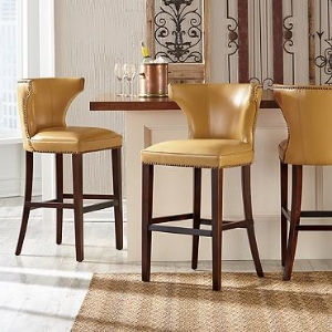 "Morgan stools feature a graceful, contemporary style with a beautiful sculpted back. They are available in a number of colorful leather options.  These stools are super comfortable with a spacious 23"" wide seat!"