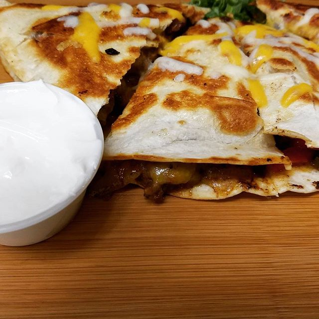 One of our Happy Hour specials... 3pm-7pm daily. $3 half quesadillas  Buffalo Chicken|Chicken Fajita|BBQ Chicken|Chicken Chimichurri|Southwest Grilled Veggie  #quesadilla #mexican #mexicanfood #tacos #chicken #chickenquesadilla #happyhour #foodie #buffalofood