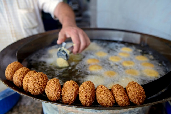 Falafel frying in oil