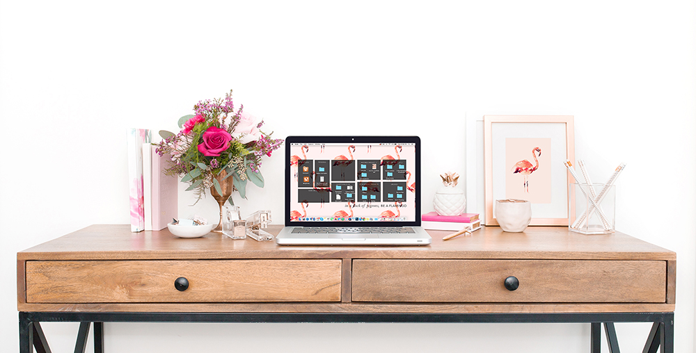 Another genius example from Leah Remillét — she added her flamingo print to the frame mockup, as well as her matching downloadable digital wallpaper on the laptop, to truly customize this styled desktop.