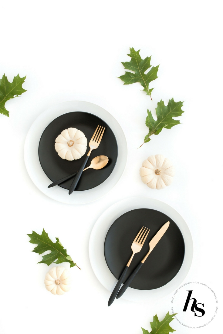 A modern, minimal Thanksgiving Tablescape styled stock photo from Haute Stock featuring a neutral palette of white, green, gold and black.