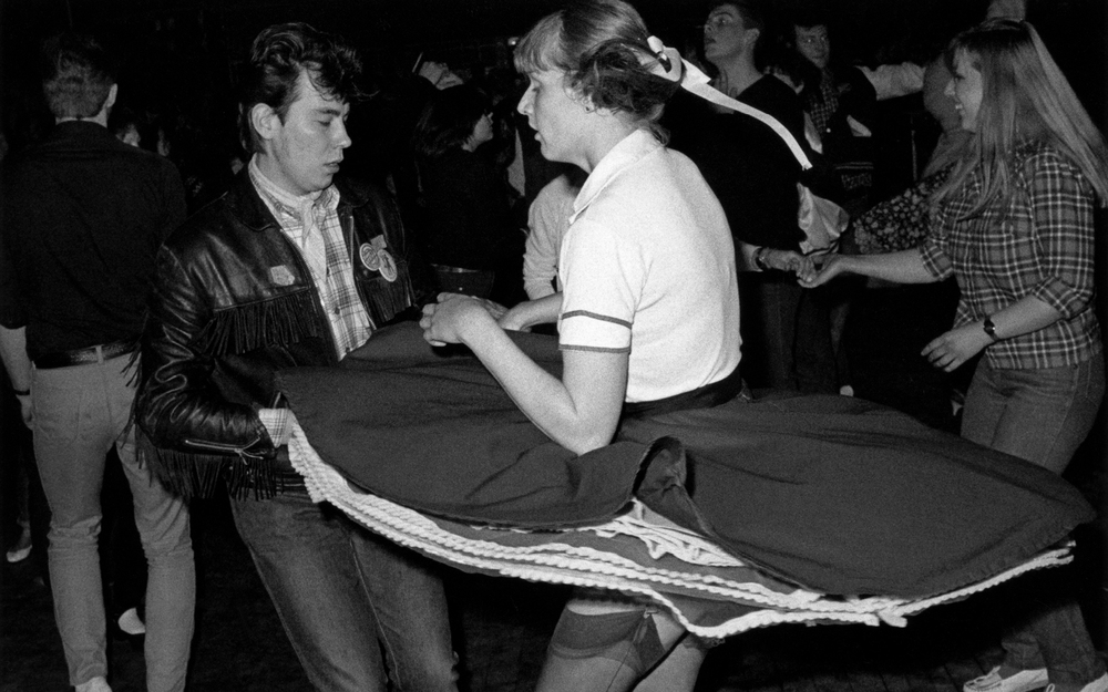 A Teddy Boy couple Rock 'n' roll dancing, Caister, Great Yarmouth, UK 1980. © Janette Beckman / PYMCA