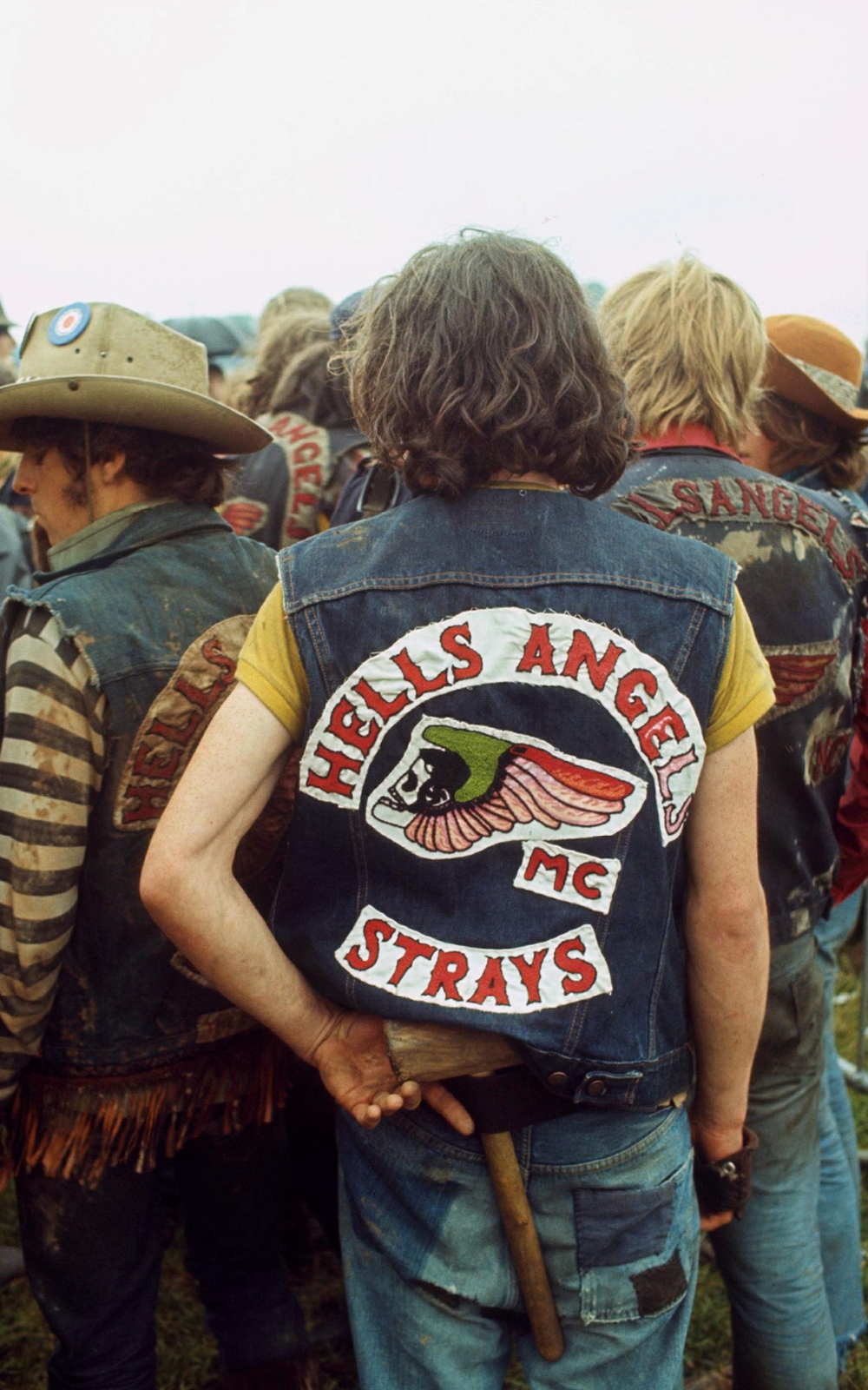Hells angel with concealed weapon at pop concert. Bath festival, UK - 1970  ©   BRIAN MOODY / Rex Features   / PYMCA