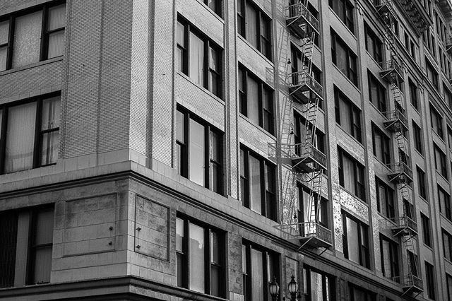 Modern safety standards have done away with the need for those rickety old fire escapes. I guess that's for the best, but it has led to a different look in cities. I'm pretty thrilled that I probably won't ever need to climb down one of these, but I did love watching the sun reflect off of this building in Downtown Los Angeles.⠀ ⠀ --------------------⠀ ⠀ #fireescape #fireescapes #dtla #dtlaphotography #downtownla #downtownlosangeles #architecture_hunter #architecture_view #architecture_lovers #architecture_greatshots #architecturephoto #architecturedetail #architecturedaily #buildingart #buildinglovers #buildingscape #citystreets #citylove #citygram #urbandesign #urbandetails #urban_shots #urbanstreet #citylimitless #blackandwhitearchitecture #bnwarchitecture #black_n_white #bnw_unlimited #bnw_fanatics