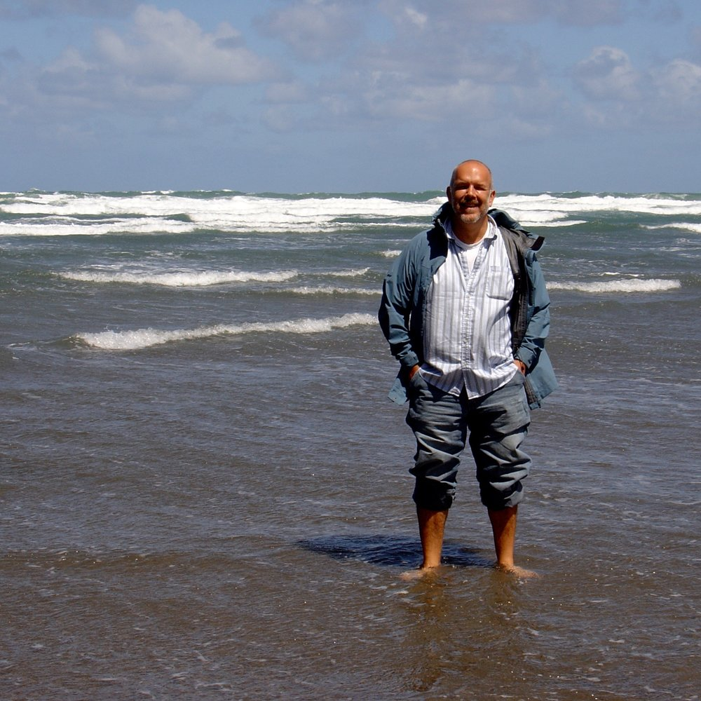 ALBERT  teaching his  APP DESIGN MASTERCLASS  in New Zealand. That's the Tasman Sea he's standing in.