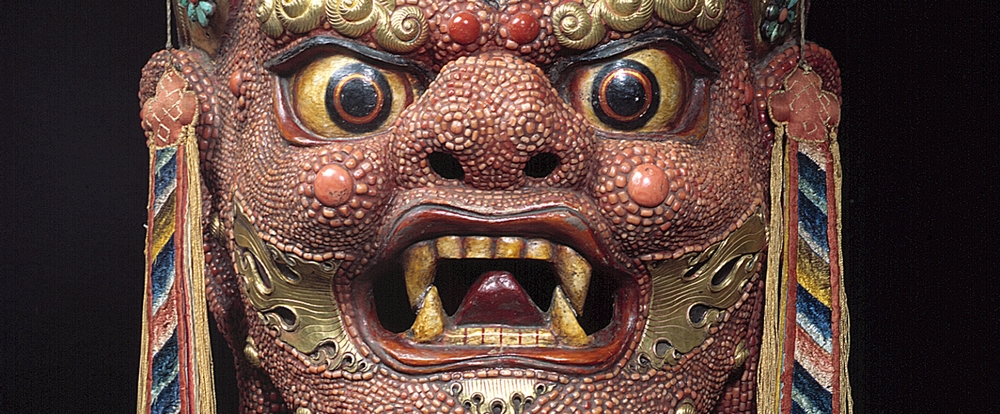 "The Mask of Begtse, Mongolia, ca. Early 20th Century, Papier-mâché, coral, metal, and fabric. (This work was part of  ""Becoming Another: The Power of Masks,"" The Rubin's recent Collaboration with the Poetry Society of America.)"