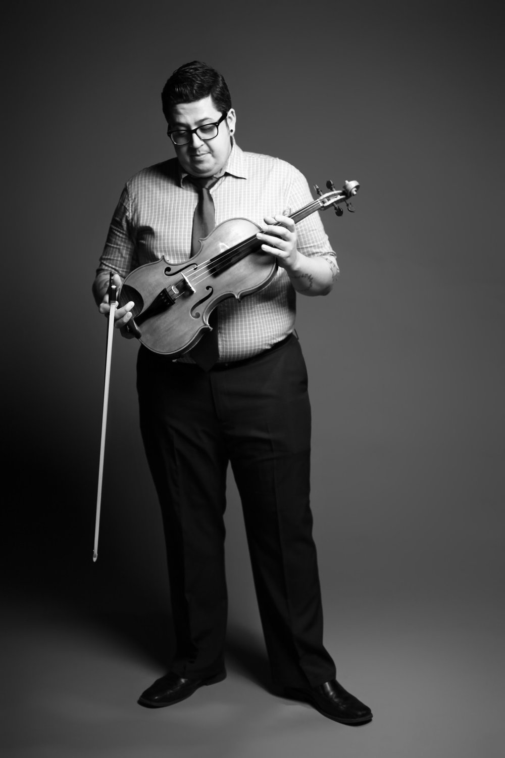 "Composer and instrumentalist Sean Neukom began his violin studies at the age of three at joint lessons with his brother, Jason. These lessons, taught by their father, laid the foundation for an intense love, respect, and appreciation for music and for making music as brothers. This love of music took Sean to Minot State University where he received a Bachelor in Music degree, under Dr. Jon Rumney. While at MSU Sean's musical curiosity lead to the start of compositions in the form of exercises. Following Minot, Sean went on to the Cleveland Institute of Music to earn a Master of Music degree in violin performance under the violin division head at the time, David Updegraff. Sean's mainstay as a performer is as the violist, and as a founding member, of Beo String Quartet. Prior to Beo String Quartet, Sean played violin in the Milhaud Trio for three years. (In 2007 the Milhaud Trio gave one of the few American performances of Darius Milhaud's only piano trio with the composer's wife in attendance.) Additionally, Sean studied the inner workings of chamber music extensively with members of the Ying Quartet and with Peter Salaff of the Cleveland Quartet. When not performing with Beo String Quartet, Sean is the principal 2nd violin with the West Virginia Symphony Orchestra. Leading up to the winning of this post, Sean played violin in many top ensembles including the Nashville Symphony and the New Zealand based Southern Sinfonia. As a composer, Sean's works cover a wide range of styles. His concert works have been commissioned by organizations such as the Pittsburgh New Music Ensemble, the Charlotte-based Fresh Ink new music series, the innovative multi-media music and dance group Cadence Collective out of Milwaukee, and most recently by the Dayton Philharmonic Orchestra (DPO). The DPO commissioned Sean to write a violin concerto for their illustrious concertmaster, Jessica Hung Calligan, and will be premiering the work in May 2018. Sean's pop-art works are self produced and are approached through the same creative means as his concert works, but with the goal of reaching ears both in and out of a concert hall. Such albums include The Ghost & Mr. Able, Dead Reckoning, and a yet to be named new album currently being composed. Beo String Quartet, being joined by two other stunning musicians, will be starting to perform these albums live in 2017 under the name of ""The Beo Plug-In"". An awareness of the changing ways in which music is consumed and produced in the 21st century has lead Sean to really consider how music groups and organizations are managed. His first step into such waters was with the organization named Symbiotic Collusion that ran from 2011 to 2014. This group was run as a for-profit outfit and with the notion that by having products and services to sell one could finance their own artistic projects. Elements of this have been brought to Beo String Quartet but with the necessary tweaks all endeavors require. Sean believes that music is one of the most enriching elements for humankind and that the modern musician needs to know how to market and illicit a call to action just as well as play their instrument. This combination of an intense love for chamber music, a desire to connect different audiences through like music, and a practiced sense of entrepreneurship through music has shaped Sean's early and developing career."