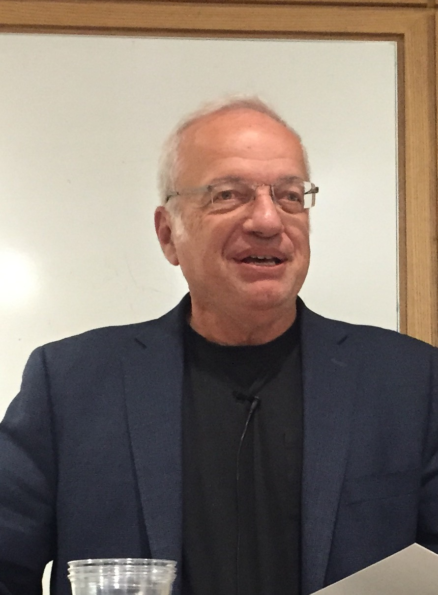 "Michael Salcman, photo graphed here at a reading in November 2015 at the Columbia University Medical Center to celebrate the literary & fine arts journal, Reflexions, is a poet, neurosurgeon, and art historian, formerly chair of neurosurgery at the University of Maryland and president of the Contemporary Museum in Baltimore. He is the author of six medical textbooks and six collections of verse, including The Clock Made of Confetti and The Enemy of Good Is Better.  Dr. Salcman reads the poem, ""The Clock Made of Confetti"" below."