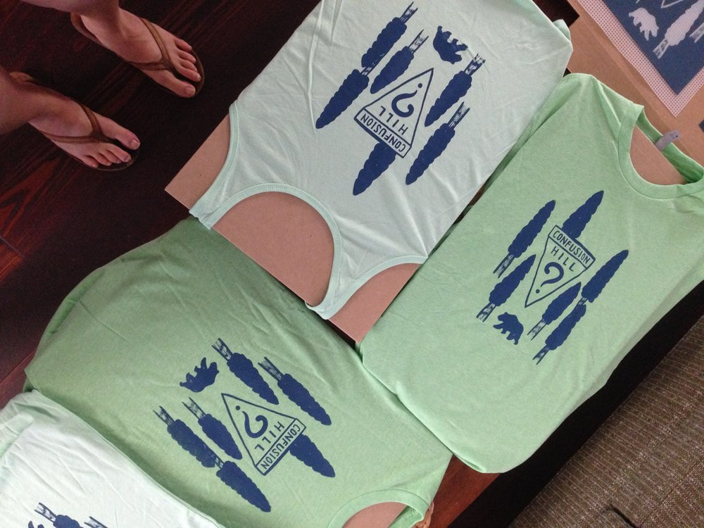 T-Shirts and Racerback Tanks available for both designs.