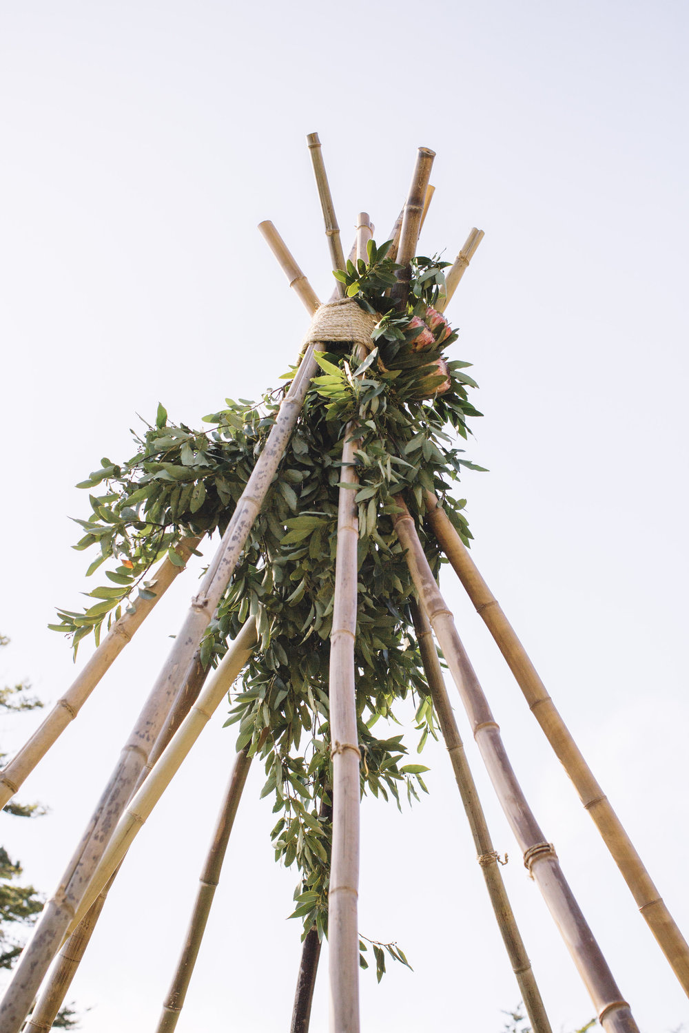 Bamboo Teepee and with greenery and florals by Venn Floral | Photo by Lucille Lawrence