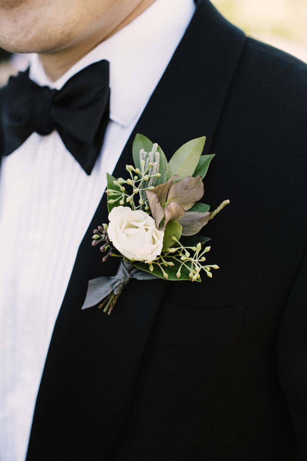 Groom's Boutonniere by Venn Floral | Photo by Lucille Lawrence