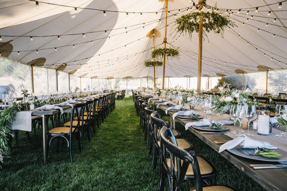 Greenery Chandeliers and flowers by Venn Floral in Sea Ranch | Photo by Lucille Lawrence