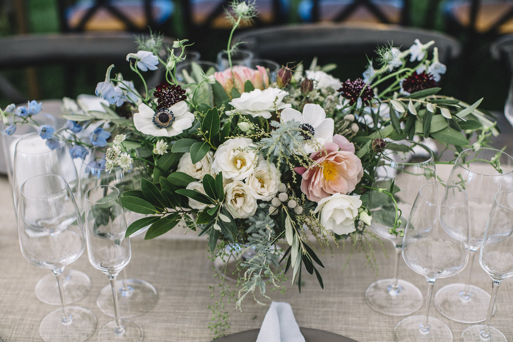 Table centerpiece with Distant Drums Garden Roses, Nigella, Anemones, Olive, California Bay Laural, Black Knight Scabiosa by Venn Floral  | Photo by Lucille Lawrence