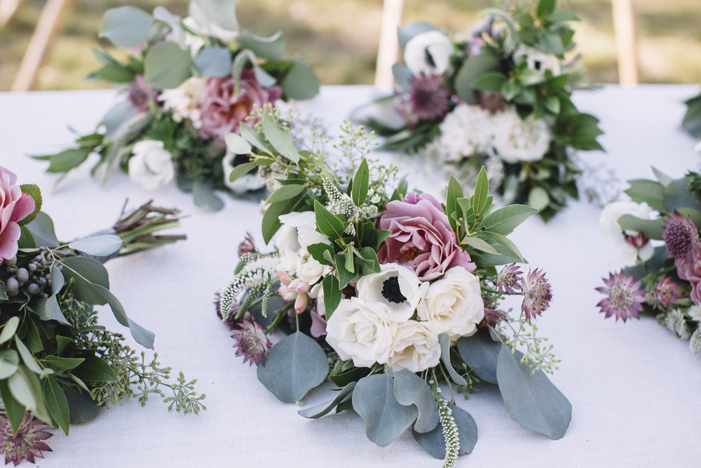 Alternative Bridesmaids Bouquets by Venn Floral to adorn ceremony structure | Photo by Lucille Lawrence