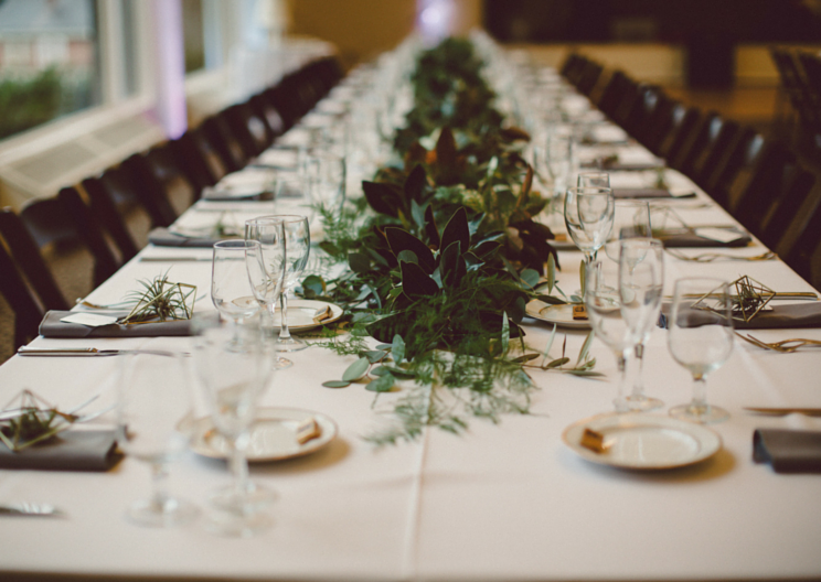 Wild greenery runner on banquet table with Tillandsia place settings by Venn Floral in San Francisco, photo by Lilly Red.