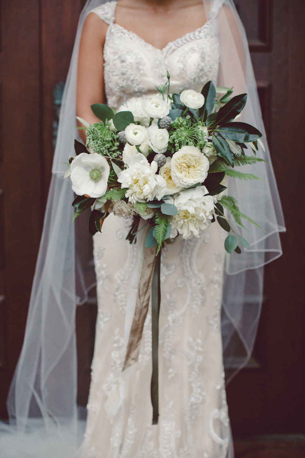 Peony, anemone, magnolia bridal bouquet with trailing silk ribbons by Venn Floral. photo by Lilly Red.