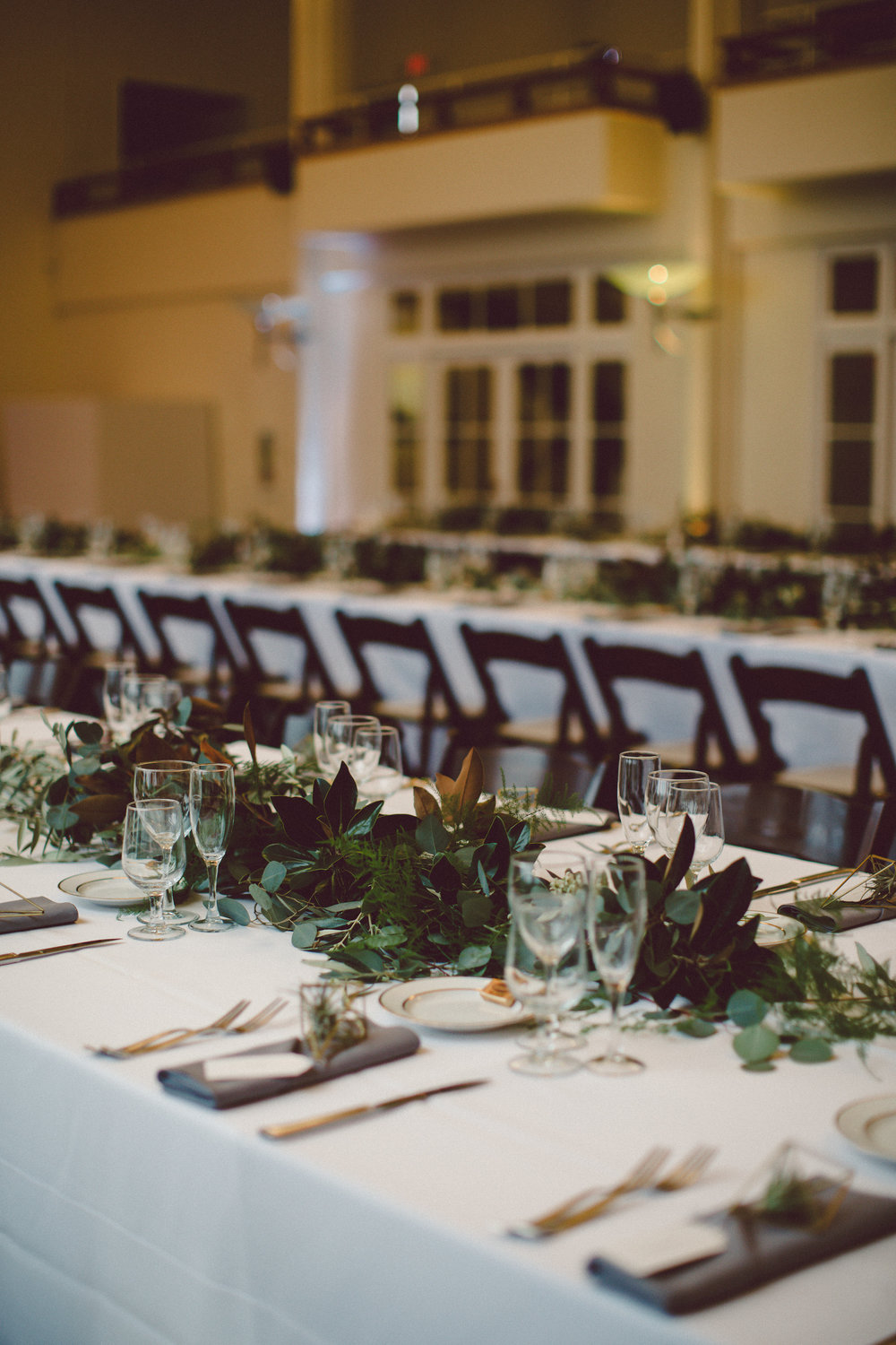 Greenery garland with magnolia, ferns and eucalyptus at The Golden Gate Club by Venn Floral, photographed by Lilly Red.