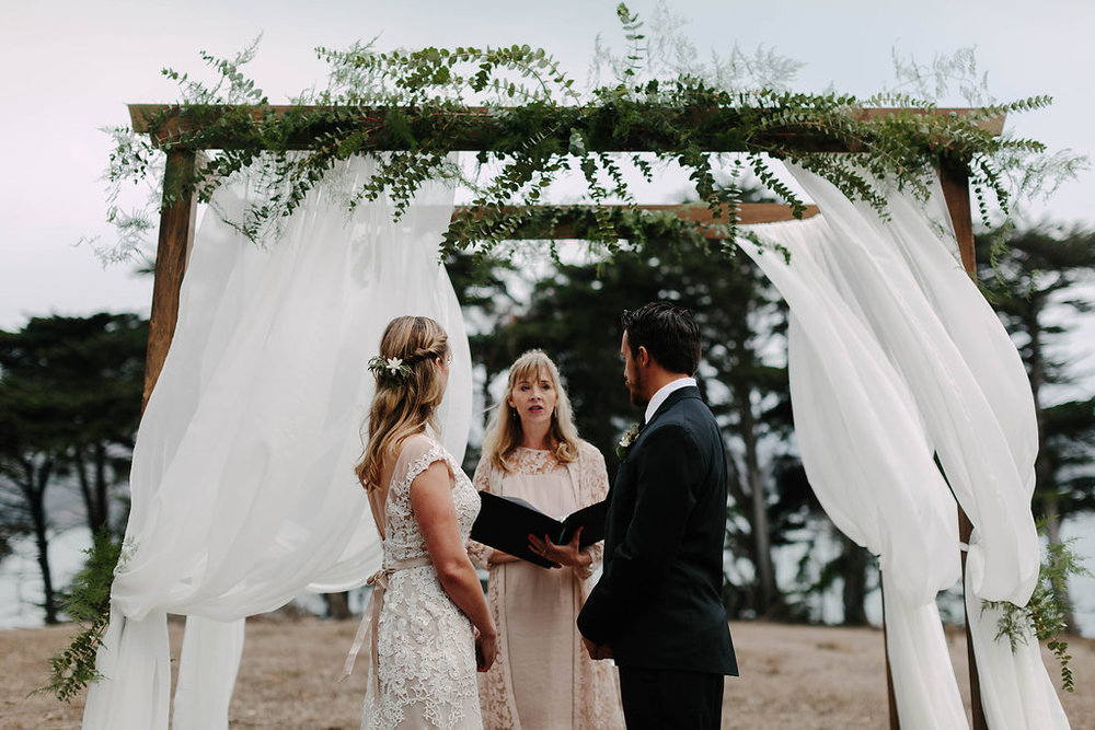 Simple greenery wedding ceremony structure by Venn Floral , photograph by Levi Tijerina at Straus Home Ranch.