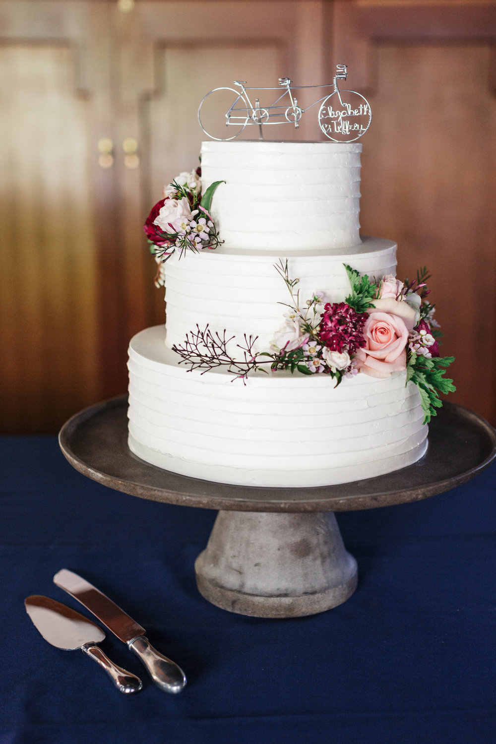 Three tier wedding cake by Branching out cakes with flowers by Venn Floral at The Outdoor Art Club in Mill Valley, California with Torrey Fox Photography, Sage Catering, and Oh Splendid Day.