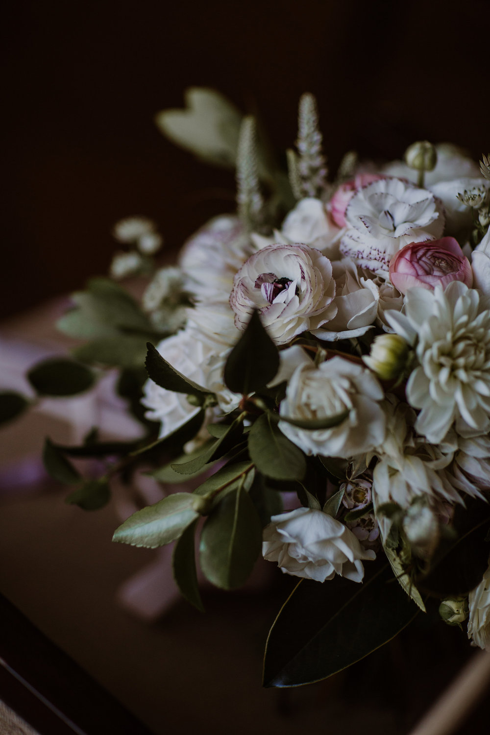 Romantic bridal bouquet with garden roses and ranunculus by Venn Floral, photographed by Gretchen Gause Photography.