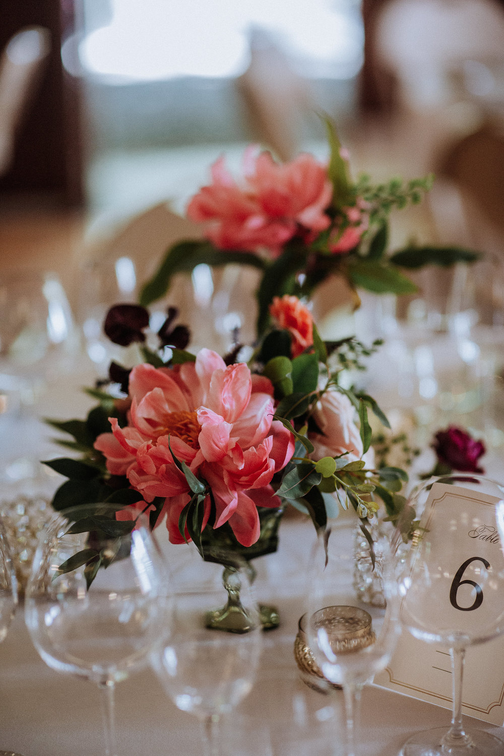 Vintage colored glass and bright florals for bohemian California wedding by Venn Floral, photographed by Gretchen Gause in Healdsburg, California.